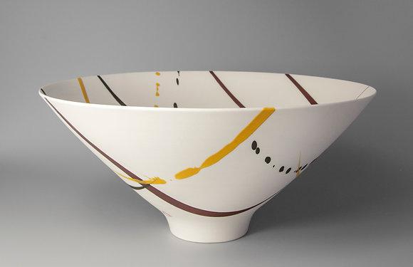 Bowl. Footed. Burgundy & yellow splash