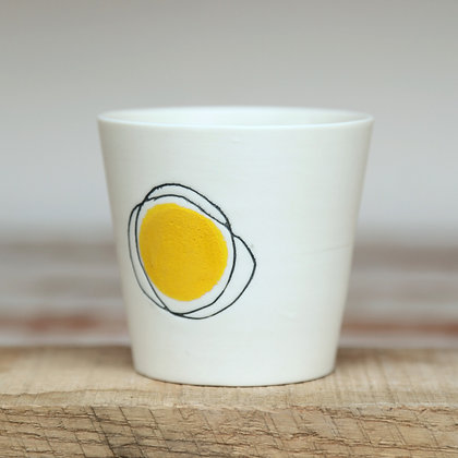 Small cup. Yellow dot