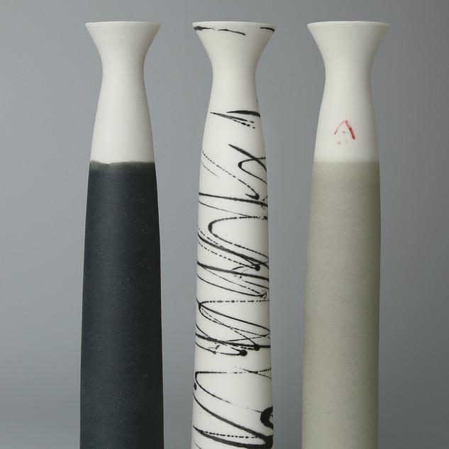 Sisters. Set of three stem vases.
