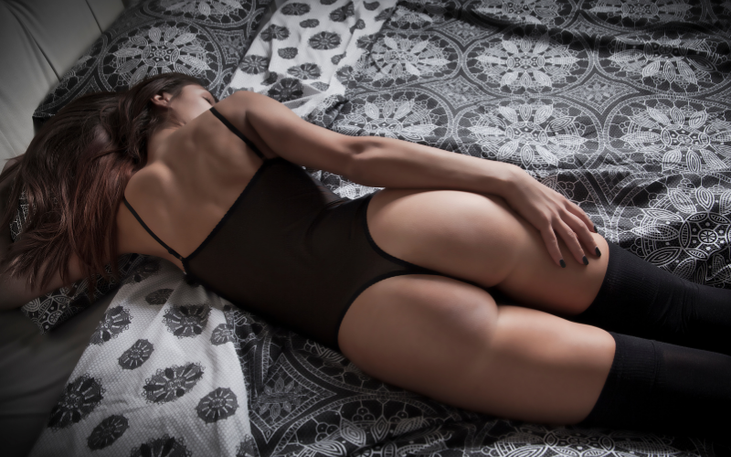 Sexy woman laying on bed in black lingerie touching her butt  Dating with Fawn   Philadelphia, PA, USA