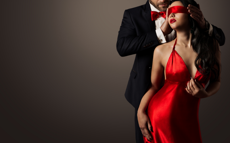 A gentleman blindfolding a sexy woman dressed in red | Dating with Fawn | Philadelphia, PA, USA