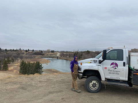 The Drain Surgeon and his truck overlooking Wakamow Valley after a sewer cleaning in Moose Jaw