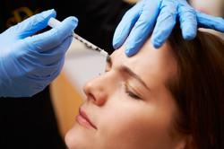 bigstock-Woman-Having-Botox-Treatment-A-64114792.jpg