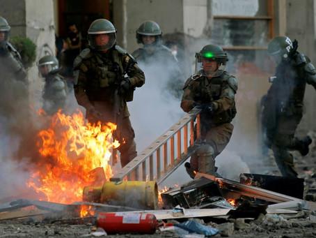 Violentos incidentes y fuerte caída del peso marcan jornada de huelga en Chile