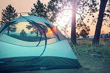 Avalanch tents image - picture of blue tent with sunset behind trees
