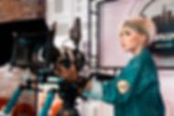 Canva - Woman Operating Video Recorder.j