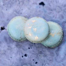 Earth Day macarons - two shades of blue with gold accents