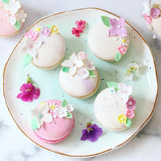 Macarons with delicate sugar flowers