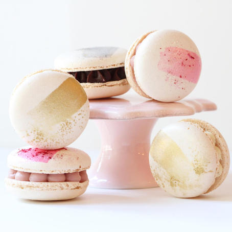 Simple macarons with a single gold brushstroke for accent