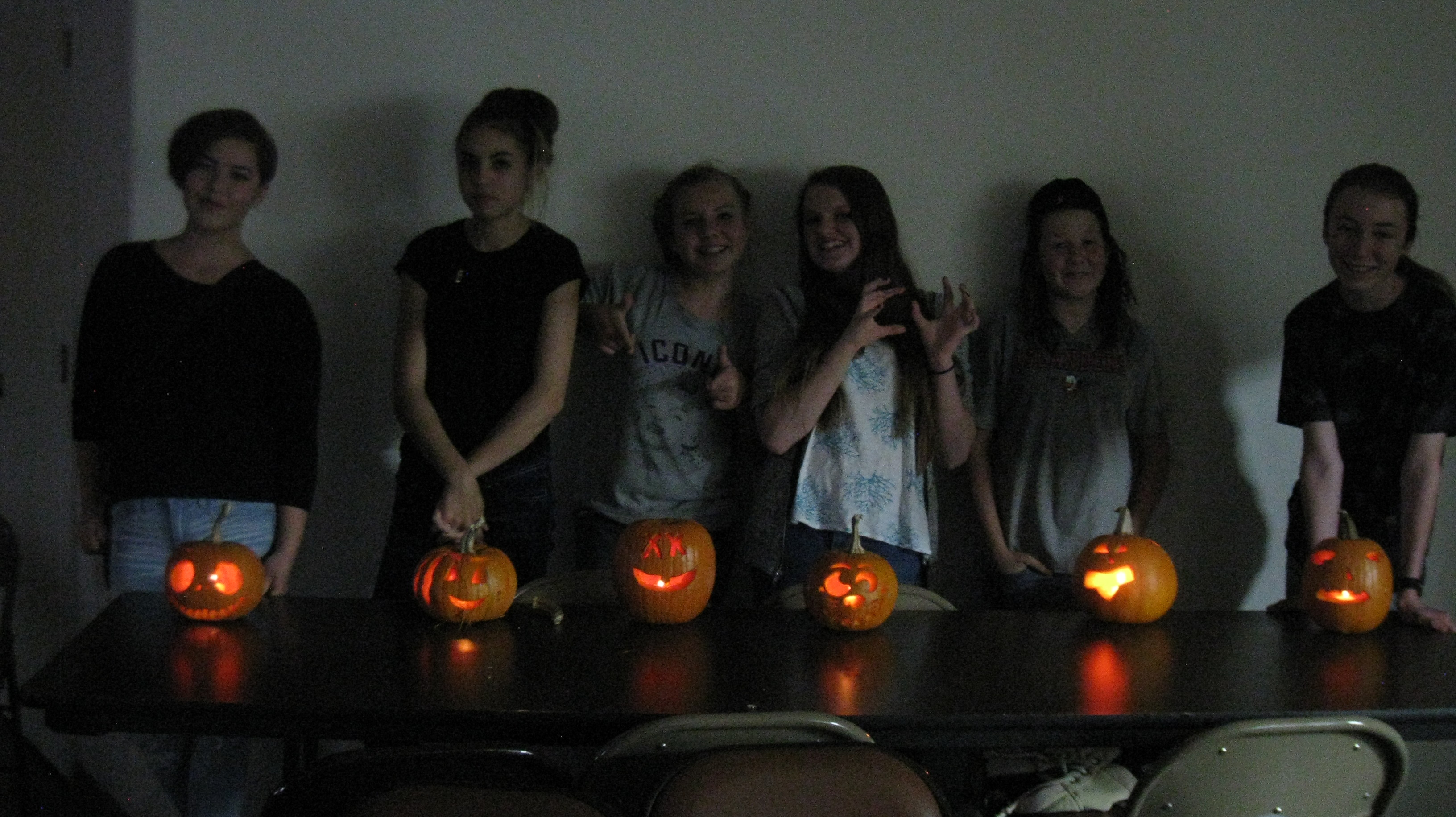Six youth with jack-o-lanterns