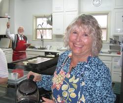 Smiling adult volunteers in kitchen