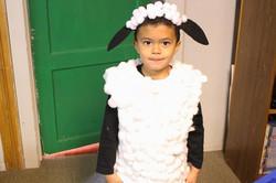 Young child dressed as sheep