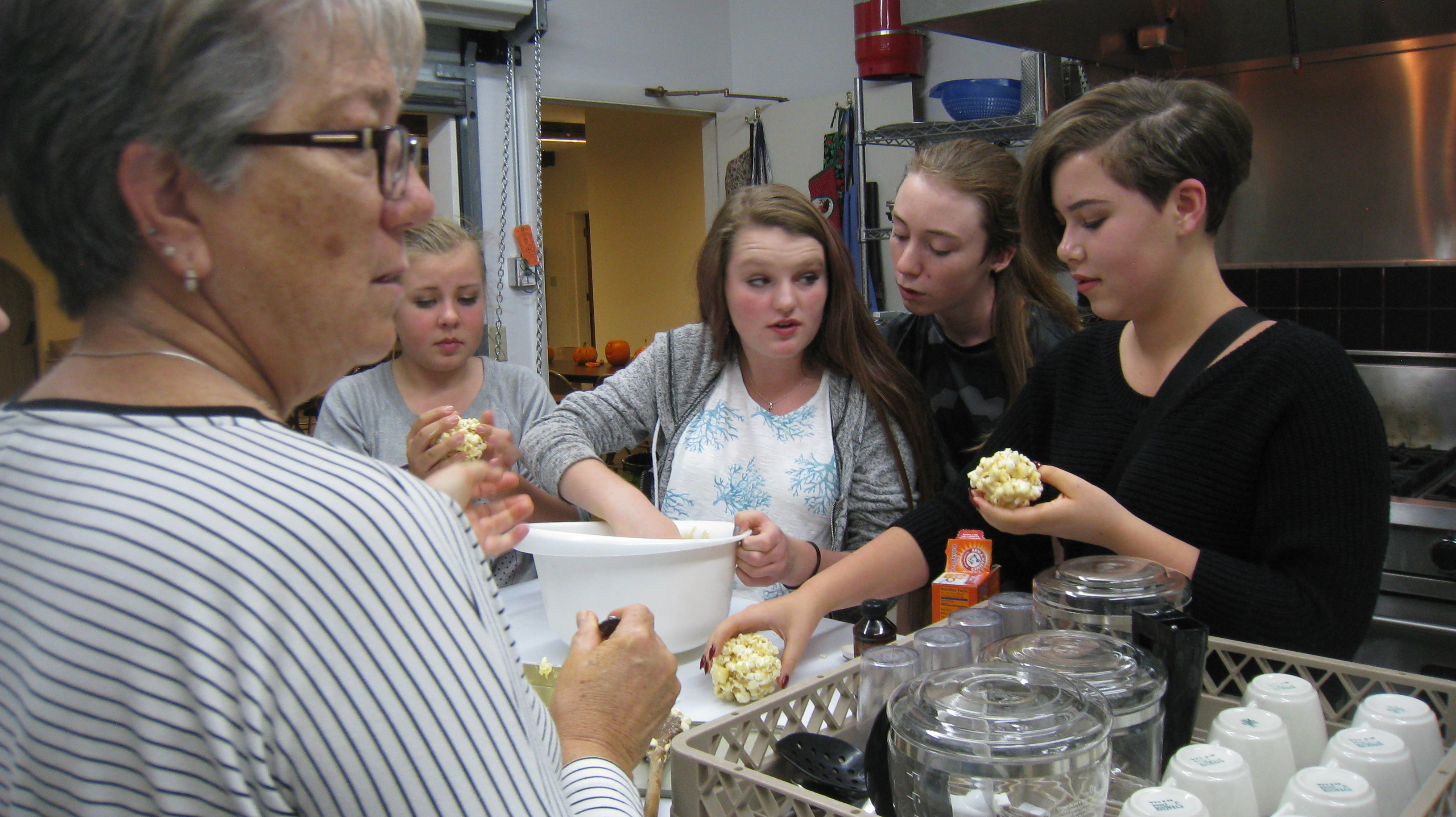 Youth group baking in the kitchen