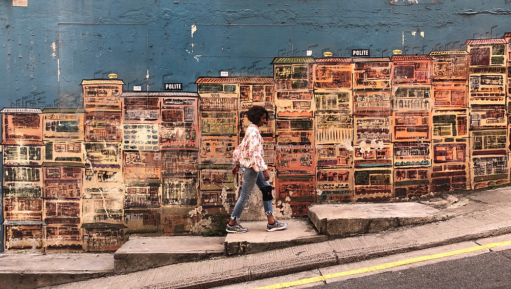 One. of the most photographed street art in Hong Kong by local graffiti artist Alex Croft. It shines a light on the city's iconic tong lau tenement buildings.
