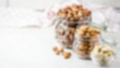Nut mix in glass jars, hazelnuts, almond