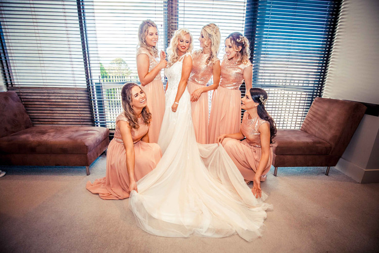 Clare surrounded by her beautiful bridesmaids.