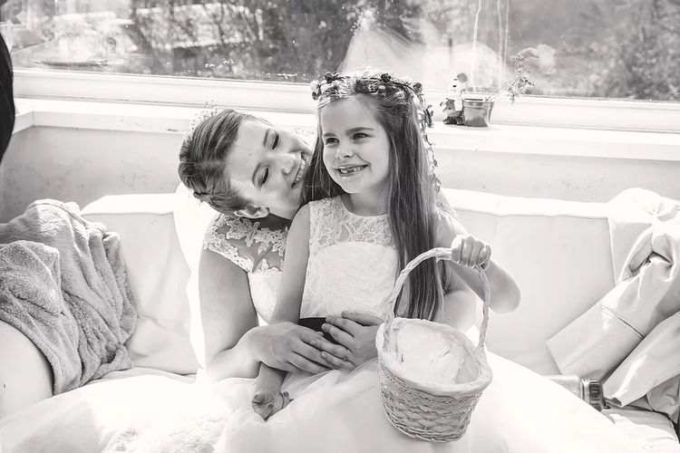 The beautiful bride Beth, sharing a moment with her flowergirl.