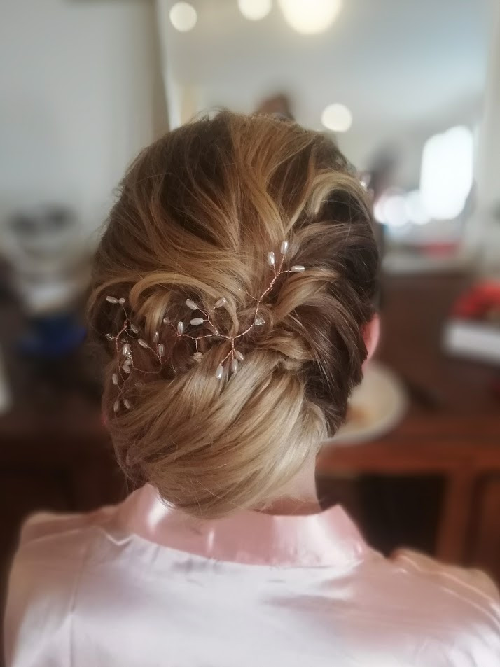 A textured boho bun hairstyle.