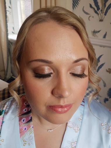 Dewy bridesmaid makeup look.