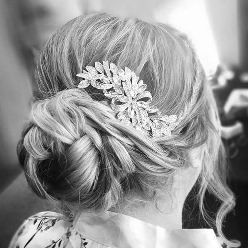 A classic bridesmaid hair up.