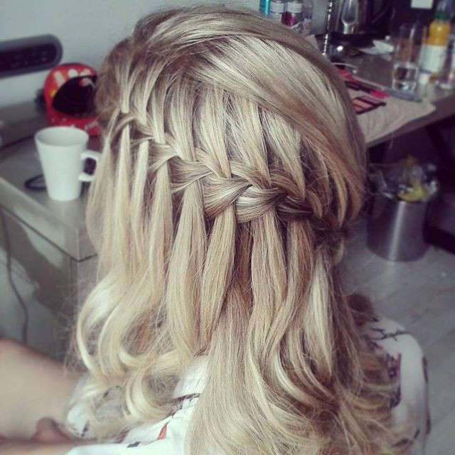 A waterfall braid with curls.