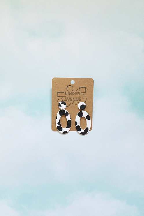 Oval Dangles in Cow Print