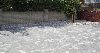 Premium paving block driveway in grey.