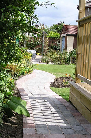 Premium paving creating paths and landscaped borders.