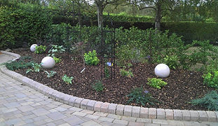 Beautiful pave edge borders and planting scheme
