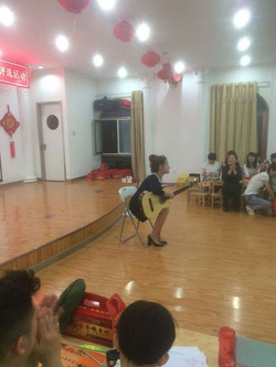 Playing the guitar to the teachers.