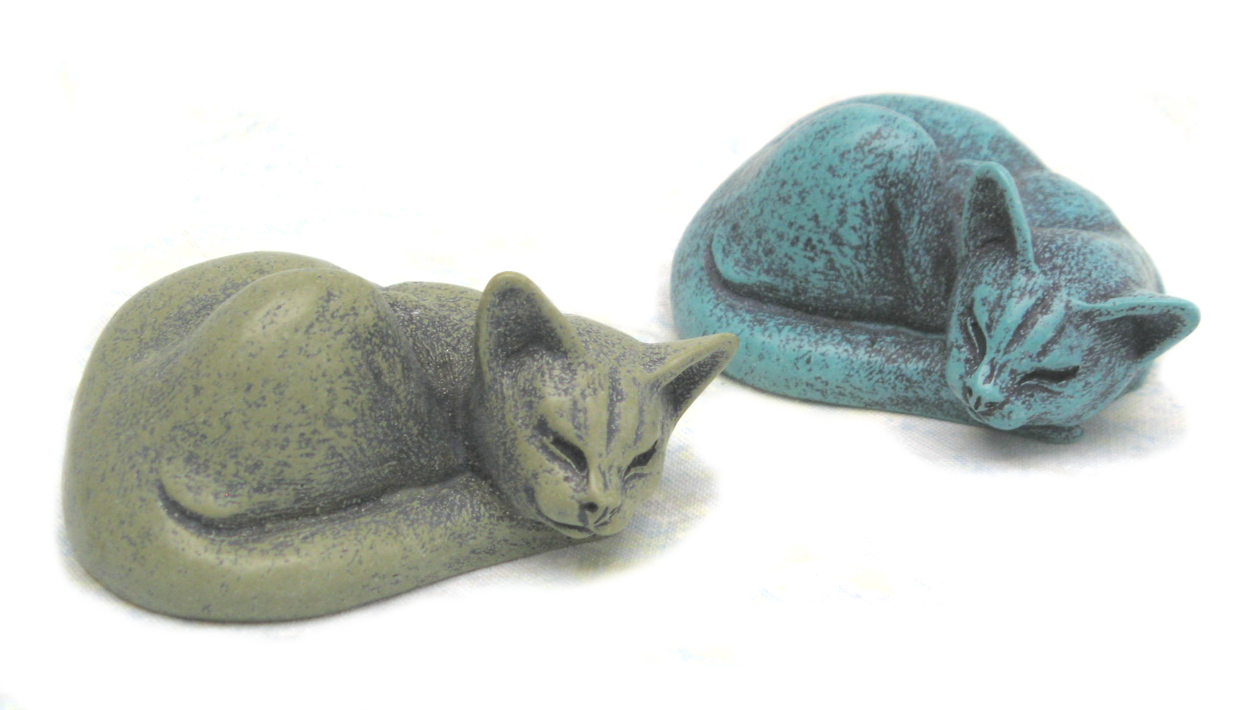 small curled cats in green & turquoise portland stone resin