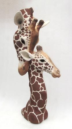 Suzie Marsh - Reassurance 2. Giraffe Heads - hand built in stoneward clay- 64cmH x 28cmW x 27cmD