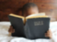 photo-of-child-reading-holy-bible-935944