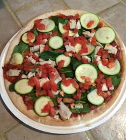 Facebook - Gluten free pizza 😊 tomato sauce, fresh tomatoes, zucchini, spinach