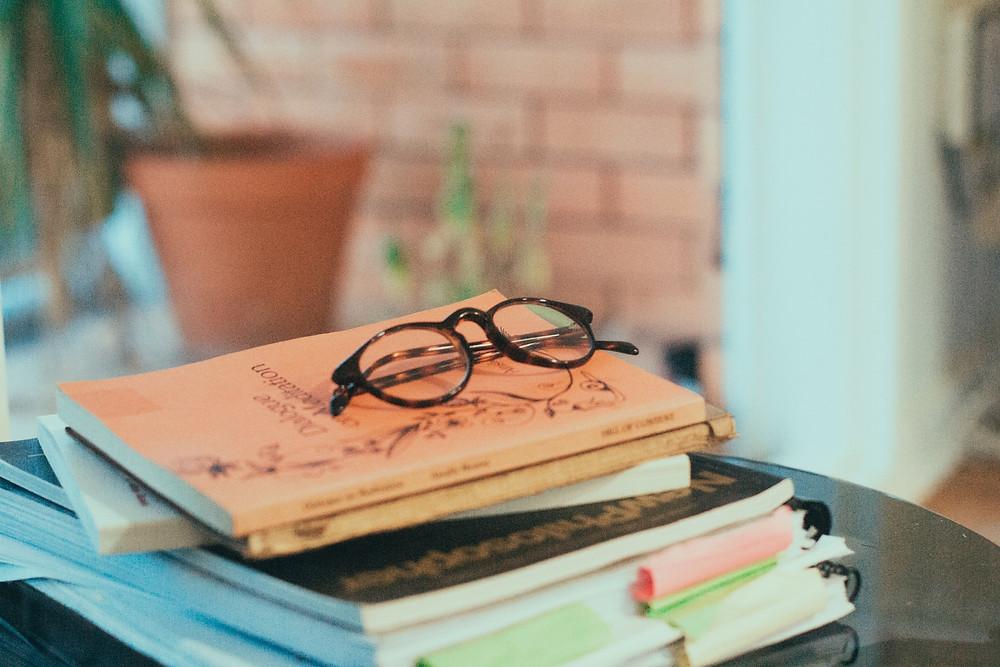 Pile of books, photo by Jade Stephens via Unsplash