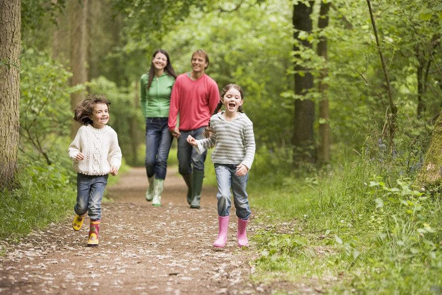 bigstock-Families-Walking-On-Path-Holdi-
