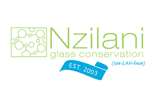 Green text spelling Nzilani Glass Logo Conservation with a blue ribbon that says Est. 2003