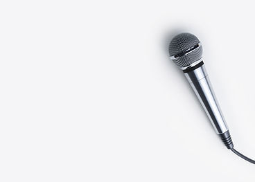 Silver handheld microphone on white back