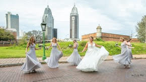 Bridesmaids in street