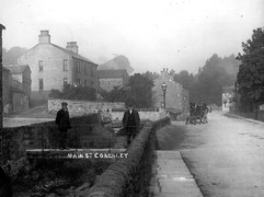 Main Street and former footbridge, early 20th c.