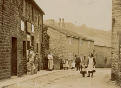 Skipton Road, Nathan Coates at his shop doorway, early 20th c.