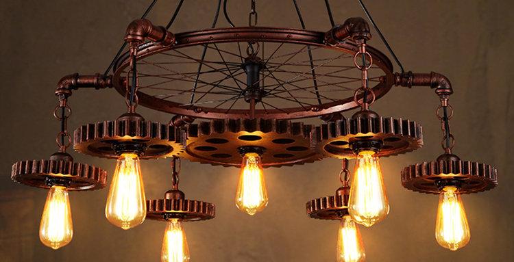 Le lustre d'anneau de roue rustique noir décoratif de LED s'allume