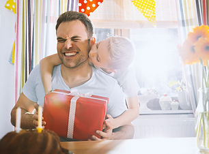 Son surprising his father with birthday present