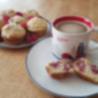 Fresh raspberry muffins and a steaming c