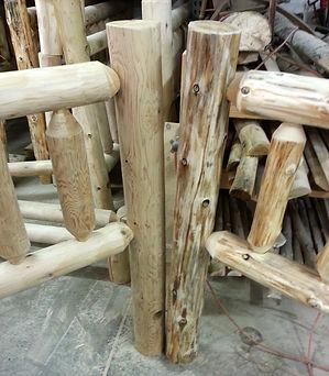 Peeled cedar logs
