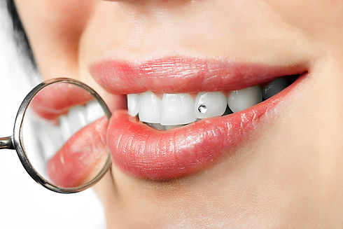 dental mouth mirror near healthy white w