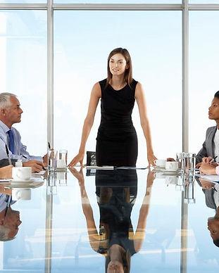 Woman-leading-board-meeting.jpg