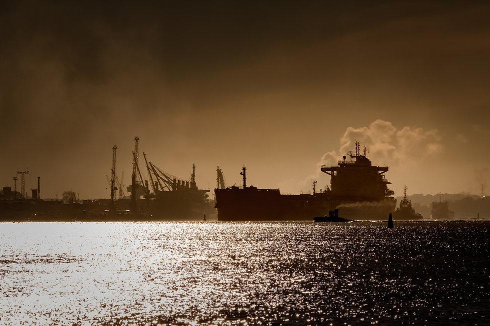 bigstock-Cargo-Ship-Silhouette-176518978
