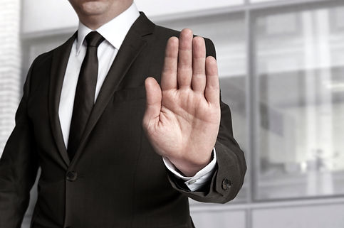 Hand stop shown by businessman..jpg