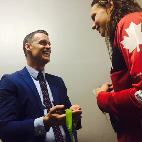 Passing the torch in 2016 to Penny Oleksiak, Rio Olympic Ganes.